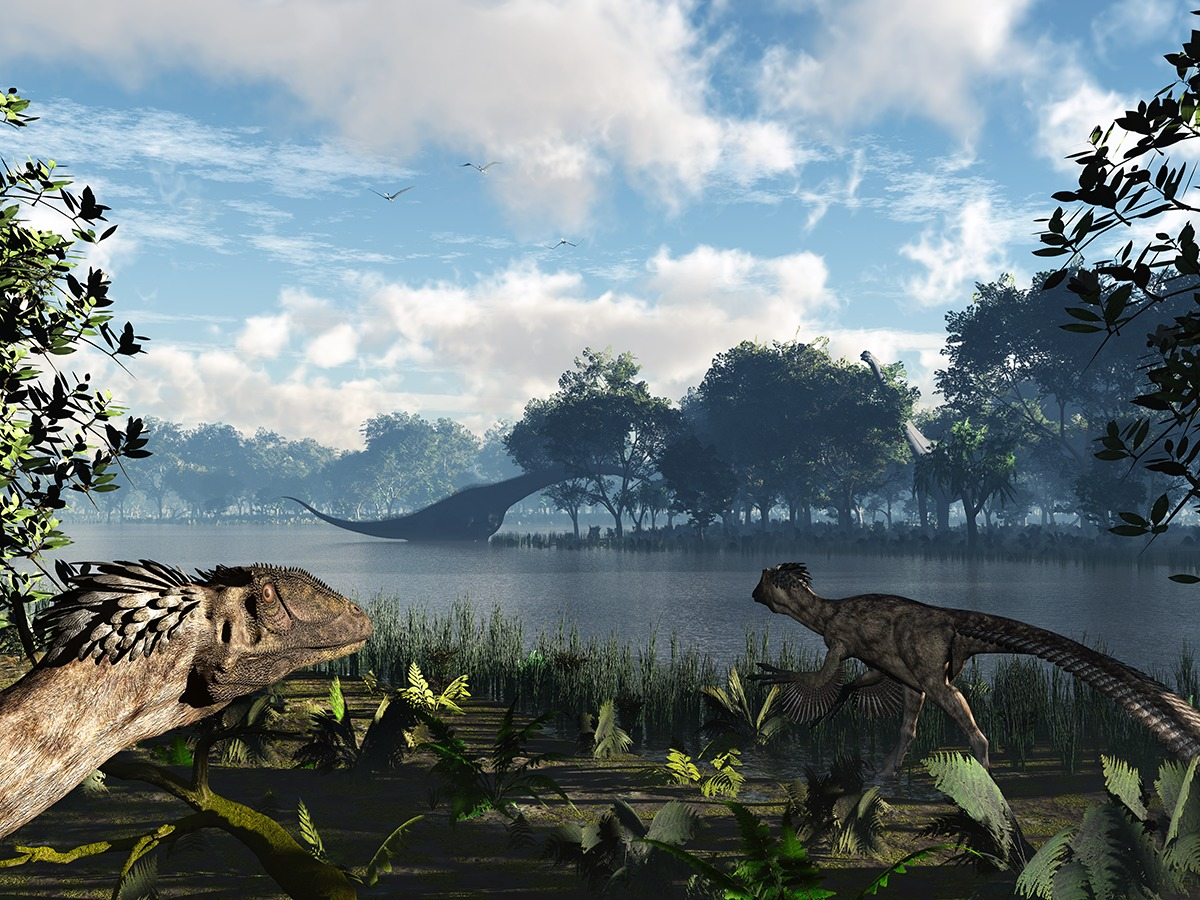 Small theropod  Deinonychus and huge sauropod Sauroposeidon that is eating early flowering plants. Velociraptors in the movie Jurassic Park were based on Deinonychus.  Image: Walter Myers